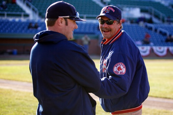 Head groundskeeper Rick Anderson shares a laugh with his assistant Jason Cooke just before game time on opening day at Hadlock Field Thursday. A scant two weeks earlier, the field was covered in nearly a foot of snow.