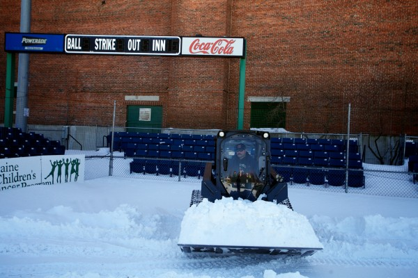 Assistant Head Groundskeeper Jason Cooke removes snow from Hadlock Field with two weeks to go until opening Day for the Portland Sea Dogs March 21, 2013.