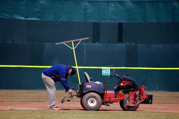 Assistant Head Groundskeeper Jason Cooke hooks up a drag before smoothing the infield at Hadlock Field in Portland April 2, 2013, with two days to go until opening day.