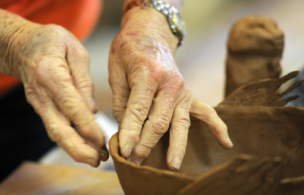 Betty Tritt, a member of the Hammond Street Senior Center, works on a swan bowl during her first pottery class, which she is taking at the Bangor center.