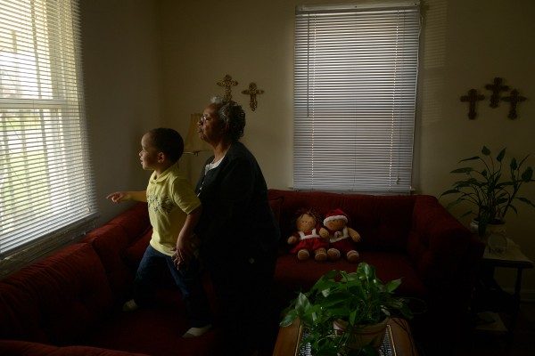 Erma Taylor, shown recently in her Falls Church, Va., home, says her great-grandson Juel Taylor Russ, who lives with her, developed allergies because of mold in the carpet in the house.