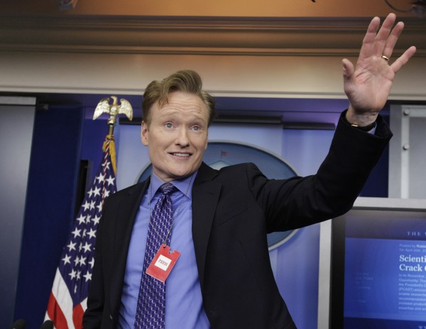 Television host Conan O'Brien poses for photographs while on a tour of the media work area at the White House in Washington, D.C., Friday, April 26, 2013, the day before the White House Correspondents' Association annual dinner.