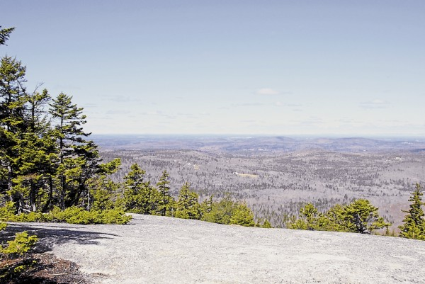 On a magnificent April 17, blue sky and thin clouds do nothing to obscure the view from Sunset Ledge on Bald Mountain in Dedham. From this viewpoint, the views encompass Bangor.