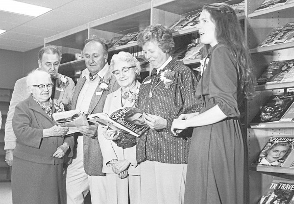 In November of 1978, librarian Karen Seidel (right) showed several Maine authors around the newly opened Orrington Public Library, adjoining the Center Drive School: (from left) John Cayford, Brownie Schrumpf, Bud Leavitt, Dorothy Clarke Wilson and Leisel Skorpen.