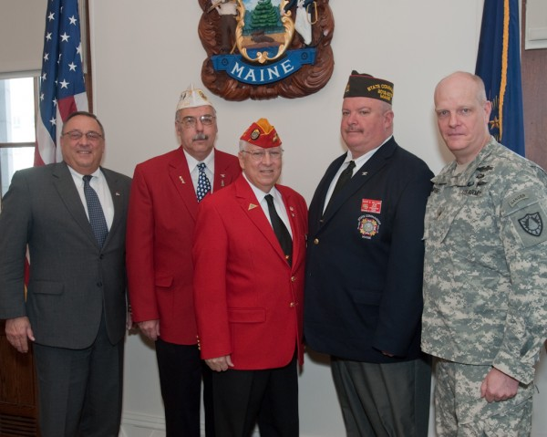 Present at the ceremony were (from left) Gov. Paul R. LePage, Richard P. Fournier, John E. Poulin, David D. Williams and Brig. Gen. James D. Campbell.