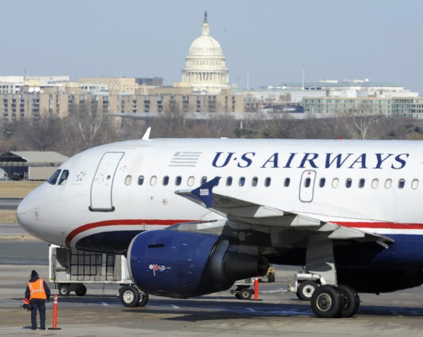 A US Airways plane arrives at Ronald Reagan Washington National Airport in Arlington County, Va. As the U.S. travel industry nears its summer upswing, airlines, hotels and other travel companies are joining the throng of companies saying they're already losing revenue to federal budget cuts that started last month and fear they'll lose much more.
