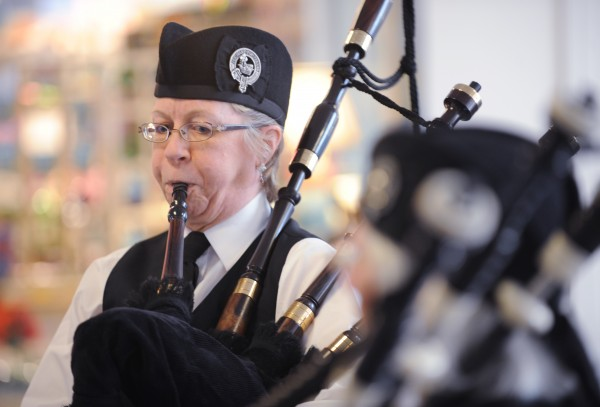 Melissa Romac, a member of the Rocky Bay Pipe Band, warms up before gathering to welcome Marine Cpl. Jacob Campbell of China  home at the Bangor International Airport on Sunday. Campbell is returning from a tour of Afghanistan and once played pipes in the band.