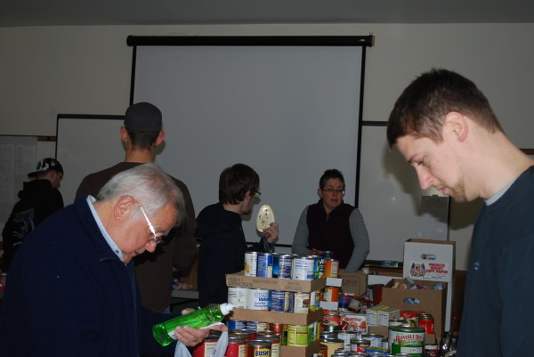 Volunteers sort donated items.