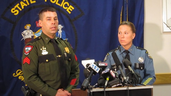 Sgt. Terry Hughes Jr. of the Maine Warden Services, left, and Maine State Police Trooper Diane Vance, shown here at this April 10, 2013 press conference in Augusta, describe extraordinary circumstances under which they arrested a man who had been living in the Maine woods for 27 years.