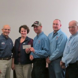 """Rich Pfirman, Barb Whitney awarding a $10,000 check from the Plummer Foundation to the Dexter Fire Dept, represented by Chief Matt Connor, Asst. Chief Rick Stocker, and Lt. Everett Hibbard on 4/26/2013 for a new """"Jaws of life"""" tool"""