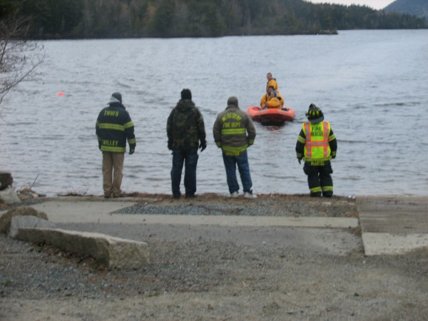 Searchers return to the boat launch at the northern end of Long Pond on Mount Desert Island on Thursday, April 18, 2013, after trying to find Corey Farley, 38, of Tremont. Farley and a friend, Richard Weimer, 66, of Charlton, Mass., are believed to have been fishing in the pond on Wednesday when their boat capsized, according to officials. Weimer's body was recovered from the pond on Thursday.