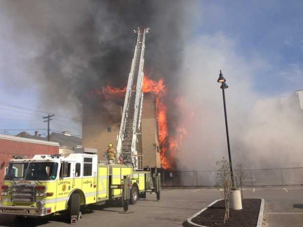 Fire is consuming an apartment building at 111 Blake Street in Lewiston, and firefighters say the fire is spreading.