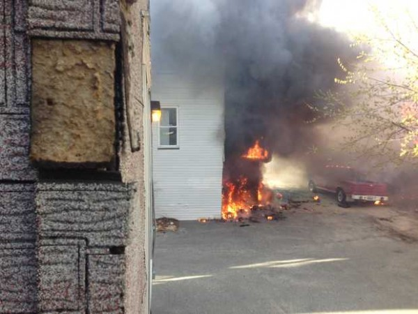 The back of a building at 172 Bates Street is on fire. The fire spread from neighboring 111 Blake Street.
