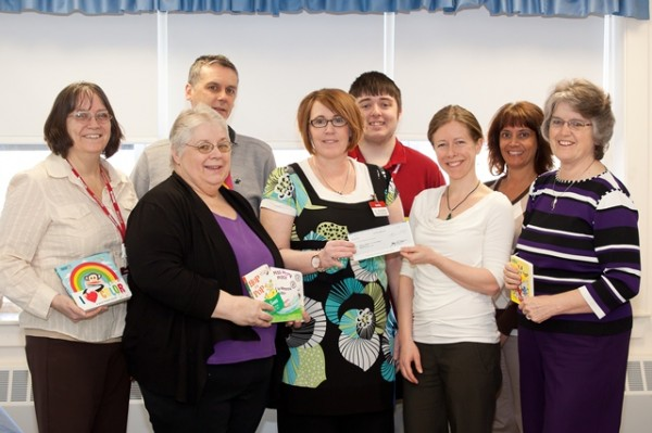 TJX Presents Check to Penquis Child Development
