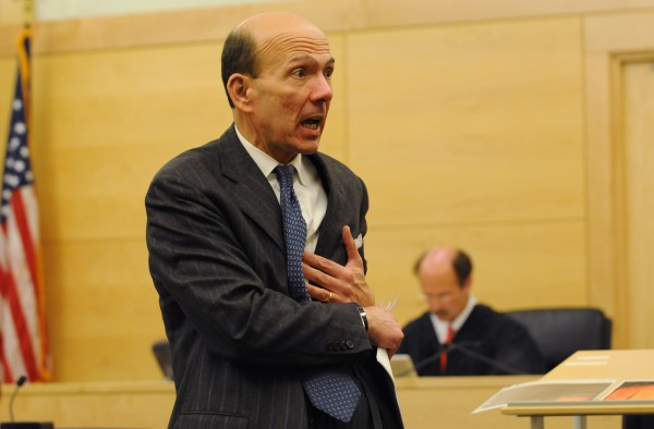 Assistant Attorney General Andrew Benson addresses the jury in his closing arguments, acting out how David Trask might have been struck with a pinch bar by Peter Robinson on Nov. 12, 2011 on Monday, at the Penobscot Judicial Center.