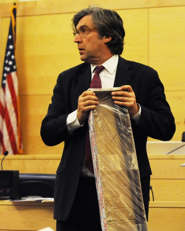 Defense attorney Thomas Hallet of Portland holds a boxed pinch bar used in the death of David Trask during his closing arguments defending  Peter Robinson against murder charges in the death of David Trask of Hudson on Monday, at the Penobscot Judicial Center in Bangor.