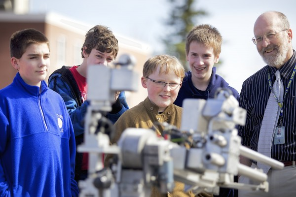 From left, Isaac Sewell, 12, Alex Ogden, 13, Dan Adam, 12, David Lavoie, 13, and teacher Michael Evans watch a demonstration by  the Bangor Police Department's Bomb Squad of their bomb robot at the William S Cohen Middle School in Bangor as part of the school's robotics class Thursday afternoon.