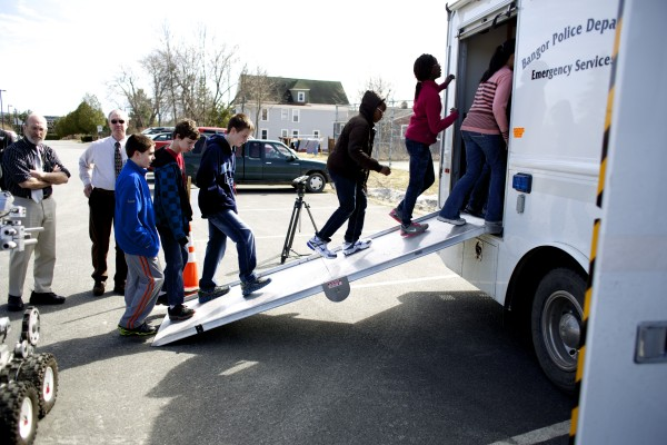 Students from a robotics class at the William S. Cohen Middle School in Bangor enter the Bangor Police Department's Emergency Services Unit Thursday afternoon while getting a demonstration of the Bangor P.D.'s bomb squad robot as part of the school's robotics class Thursday afternoon.