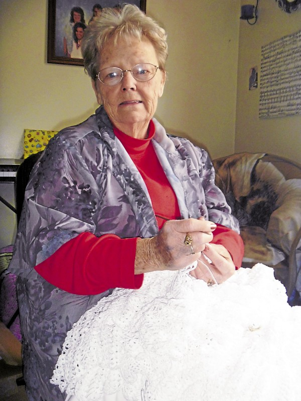Sharon Harris of Glenburn works on the skirt of a wedding dress she is crocheting for her granddaughter, Sarah Harris, of Bangor.
