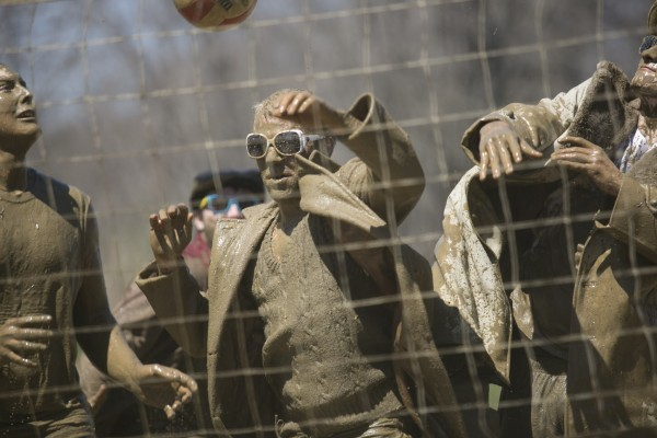 A team clad in overcoats, sunglasses and sweaters competes in the Oozeball Championships during the Maine Day celebrations at the University of Maine on Wednesday, May 1, 2013.