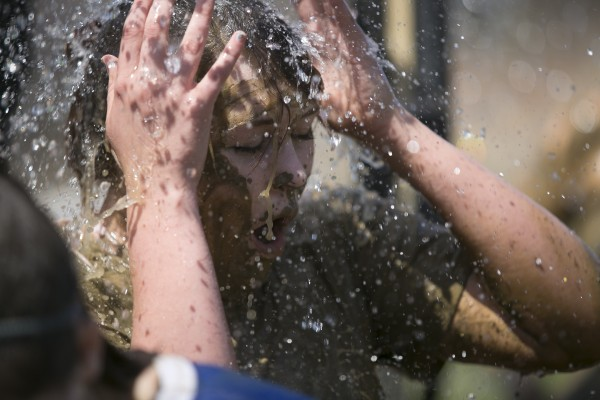 A student reacts to her cold shower after an oozeball match during the Maine Day celebrations at the University of Maine on Wednesday, May 1, 2013.