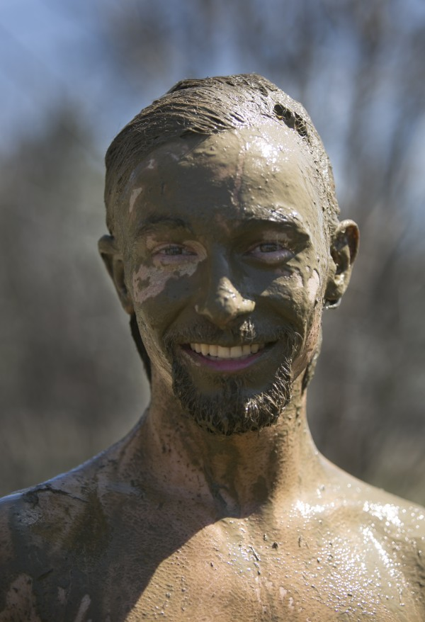 Maine freshman Kai Whitehead is covered in mud after competing in an oozeball match during the Maine Day celebrations at the University of Maine on Wednesday, May 1, 2013.