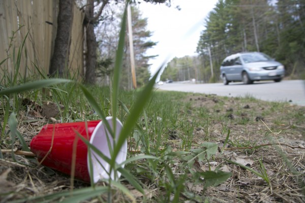 A red plastic cup lays discarded on the side of the road on Park Street near the Grove apartment complex in Orono on Thursday, May 2, 2013. Police have been called to the complex three times over the past week responding to complaints of loud noise and large crowds, said Sgt. Scott Lajoie.