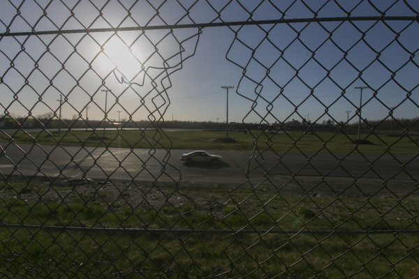 A race car zooms around the track  at Speedway 95 in Bangor on Saturday, May 3, 2013 .