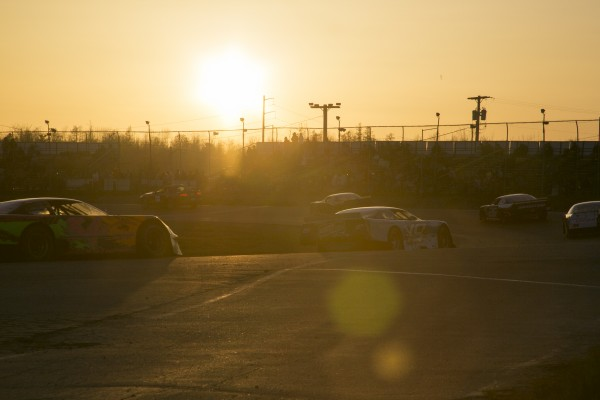 Cars make their way around the track during a caution as the sun sets on Speedway 95 in Bangor on Saturday, May 4, 2013.