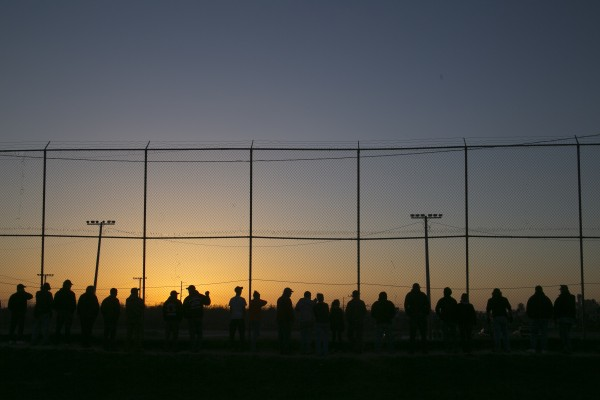 Fans line the fence r as the sun sets at Speedway 95 in Bangor on Saturday, May 4, 2013.