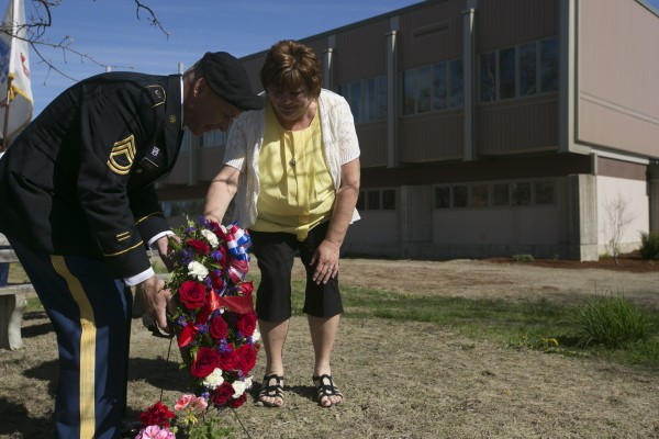 Carol Polley, right, and Army National Guard Sgt. First Class David Simmons lay a wreath in front of a memorial dedicated to her son, David Michael Veverka, at the University of Maine on Monday, May 6, 2013. Veverka, a Maine graduate and Army National Guard staff sergeant with the 172nd Infantry Division, was killed in 2006 by an improvised explosive device while serving in Iraq.
