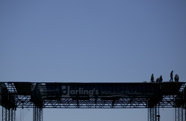 Construction workers work on top of the Darling waterfront pavilion stage on Monday, May 6, 2013.