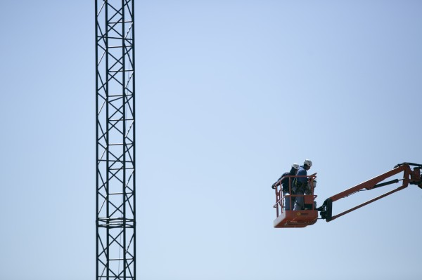 Construction workers work to construct the Darling waterfront pavilion stage on Monday, May 6, 2013.