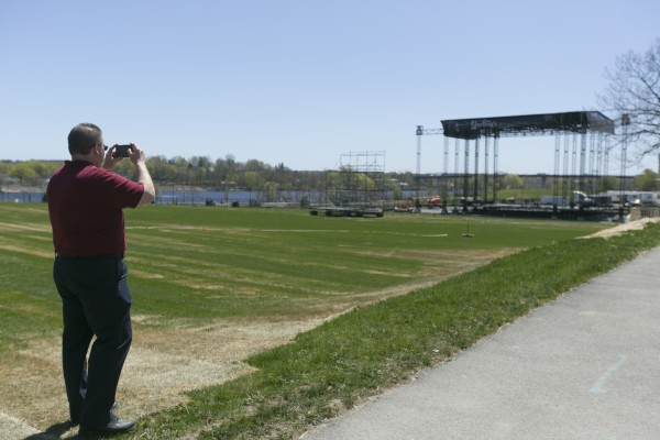 Tim Gontarz snaps a picture of the Darling's waterfront pavilion stage on Monday, May 6, 2013.