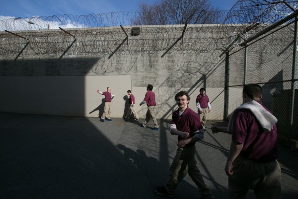 The CARA participants enjoy a brief moment of sunshine as they are transferred between the indoor recreation area and their cell block at the Kennebec County Correctional Facility. CARA groups are segregated from the general population and spend the entire program living with the other participants.