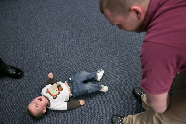 CARA participant Shawn Peaslee tries to calm his son at the end of a family visit at the Kennebec County Correctional Facility. Peaslee, 25, has two children with his longtime girlfriend but has spent a significant portion of his children's lives incarcerated. &quotMy family has most definitely stuck by side through this,&quot said Peaslee. &quotIt sucks not being with them but I am in here trying to fix myself.&quot