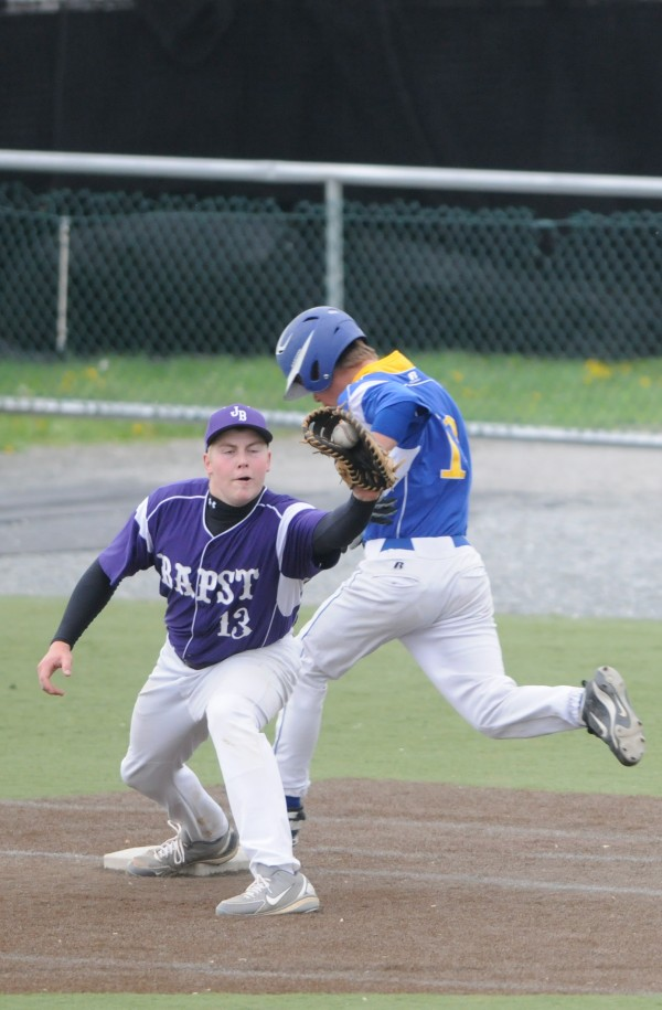 Hermon's Nick Guerette (right) can't beat the the throw to first base against John Bapst's Nolan Webber on Thursday, May 23, 2013.