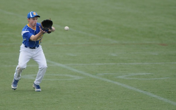 Hermon's Josh Wilson reins in a ball hit to the outfield against John Bapst on Thursday, May 23, 2013.