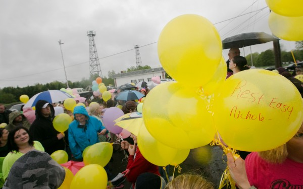 Community members gathered on Friday to released balloons in memory of Nichole Cable at the Glenburn Fire Station. Many of the balloons were yellow, Cable's favorite color, and bore messages written to her.