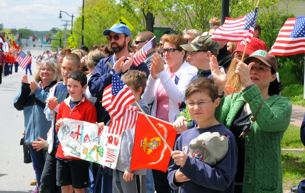 Onlookers cheers as veterans walk by. Hundreds of people lined Main Street during the Memorial Day Parade in Bangor Monday morning.