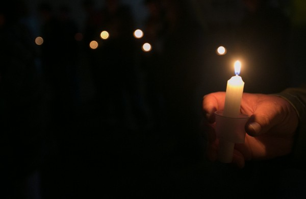 Community members gathered for a candlelight vigil to remember Nichole Cable at the East Ridge Stable in Charleston on Saturday, May 25, 2013. The event was organized by Nichole's Angels, a group that has set up a memorial fund in Cable's memory to support her family.