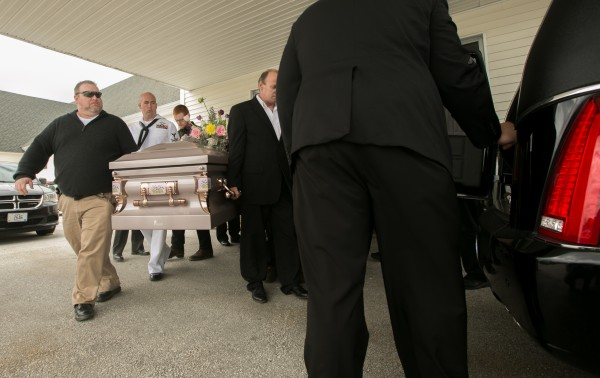 The casket of Nichole Cable  is carried out of Bangor Baptist Church after her funeral on Monday, May 27, 2013.
