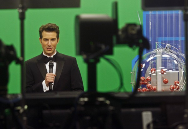 Host Sam Arlen speaks as the Powerball number is about to be chosen at the Florida Lottery studio in Tallahassee May 18, 2013.