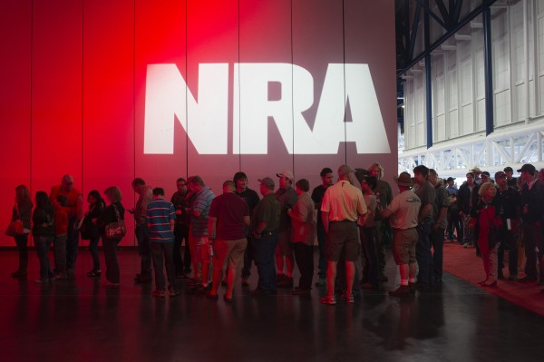 Attendees line-up at a book signing event during the National Rifle Association's annual meeting in Houston, Texas on May 5, 2013.