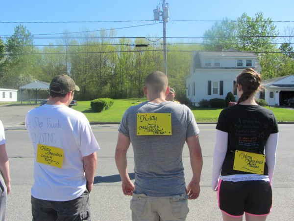 Mike McGuire (center) and Bobbi Pelletier (right) get ready Saturday morning to run a road race organized by the Student Athletes Anti-Bullying Community.