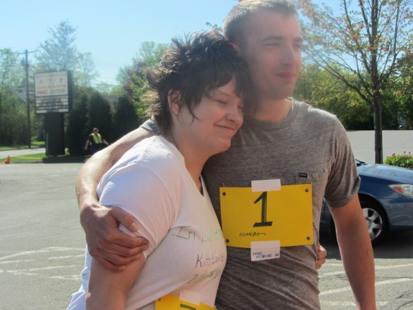 Kaitlyn and Mike McGuire hug as they sign up for a road race to raise awareness about bullying.
