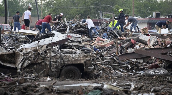 Rescuers search through rubble after a tornado struck Moore, Okla., May 20, 2013.