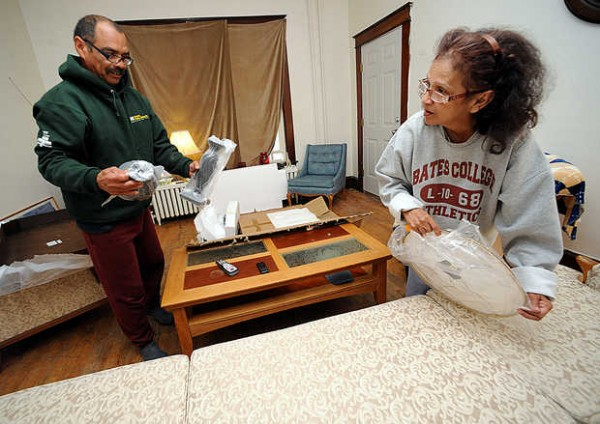 Adriana (right) and Jamie Garcia unpack boxes of furniture delivered Tuesday afternoon from Marden's by the Cumberland County Department of Corrections work crew to their new apartment on Pine Street in Lewiston. &quotI love it. It's so cozy,&quot Adriana said. &quotI am so happy with it.&quot The Garcias, along with hundreds of other people, lost their homes in a string of fires in downtown Lewiston.