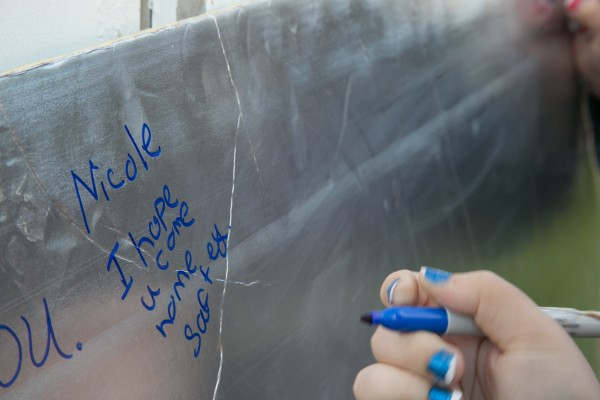 Community members write messages to missing Glenburn teen Nichole Cable during a prayer vigil at the Glenburn Evangelical Covenant Church on Saturday.
