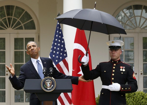 U.S. President Obama checks the need for an umbrella held by a U.S. Marine during a joint news conference with Turkish Prime Minister Erdogan in Washington on May 16, 2011.